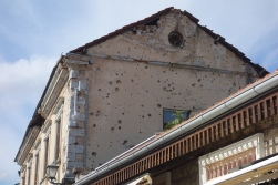 Like in Sarajevo, the buildings show scars left from from the war.